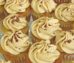 Baby vanilla cupcakes with caramel icing