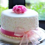 Elegant wedding cake with pink fondant roses