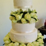 Four tiered white wedding cake
