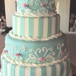 Turqouise four tiered vintage wedding cake