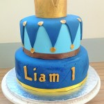 Two tiered royal blue crown cake