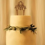 White chocolate wedding cake with olive leaves