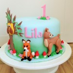Woodlands themed first birthday cake