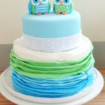 Owl two tiered blue and green ombre frills cake