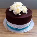 Plain and elegant chocolate baby shower cake